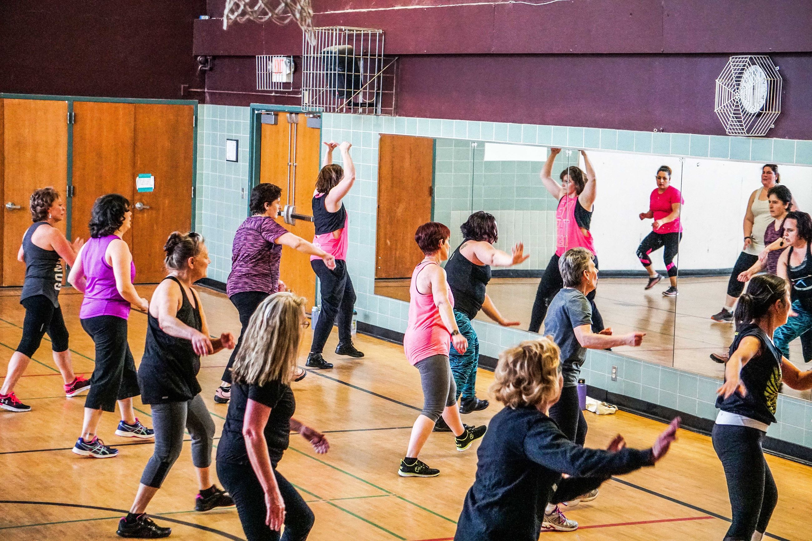 An image of individuals in a Zumba class.